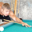 Young guy playing pool - Stock Photo