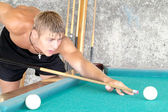 Young guy playing pool — Stock Photo