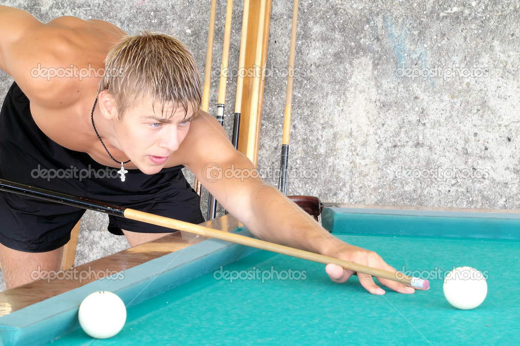 Young guy playing pool stock photo sergeykolesnikov for Pool man show