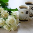 Stock Photo: Coffee and whites roses