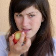 Girl and apple - Stock Photo