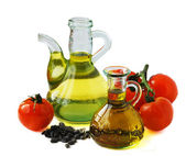 Olive oil and tomatoes — Stock Photo