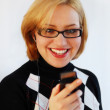 Smiling woman talking on mobile phone — Stock Photo