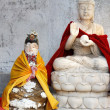 Two old Buddhist statues — Stock Photo