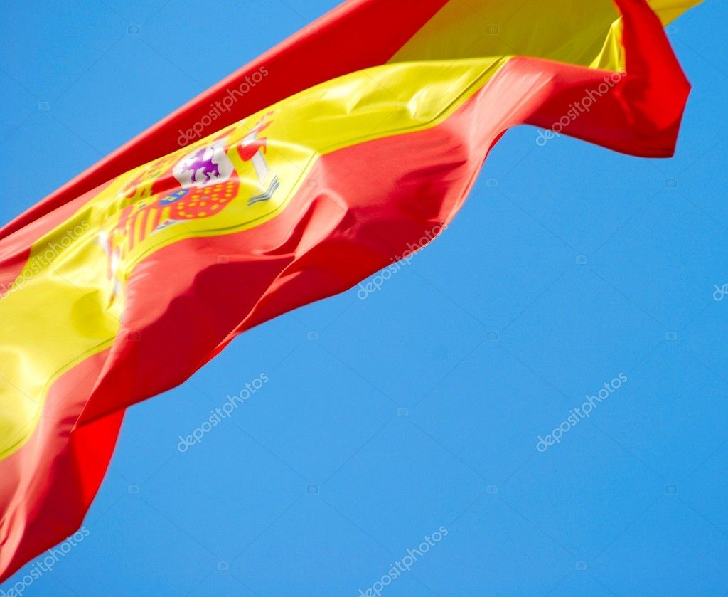 Flag of Spain against blue sky.  — Stock Photo #1180630