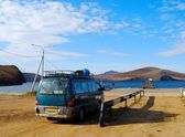 Minibus wait for a car ferry — Stock Photo