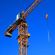 Part of crane against blue sky - Stock Photo