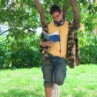 Mreading book under tree — Stock Photo #1106649