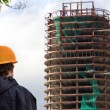 Stock Photo: Constructor look at building