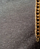 Gold chain and cloth background — Stock Photo