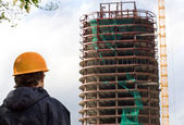Constructor look at the building — Stock Photo