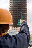 Builder look at the building — Stock Photo