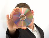 Man in the black jacket with cd — Stock Photo