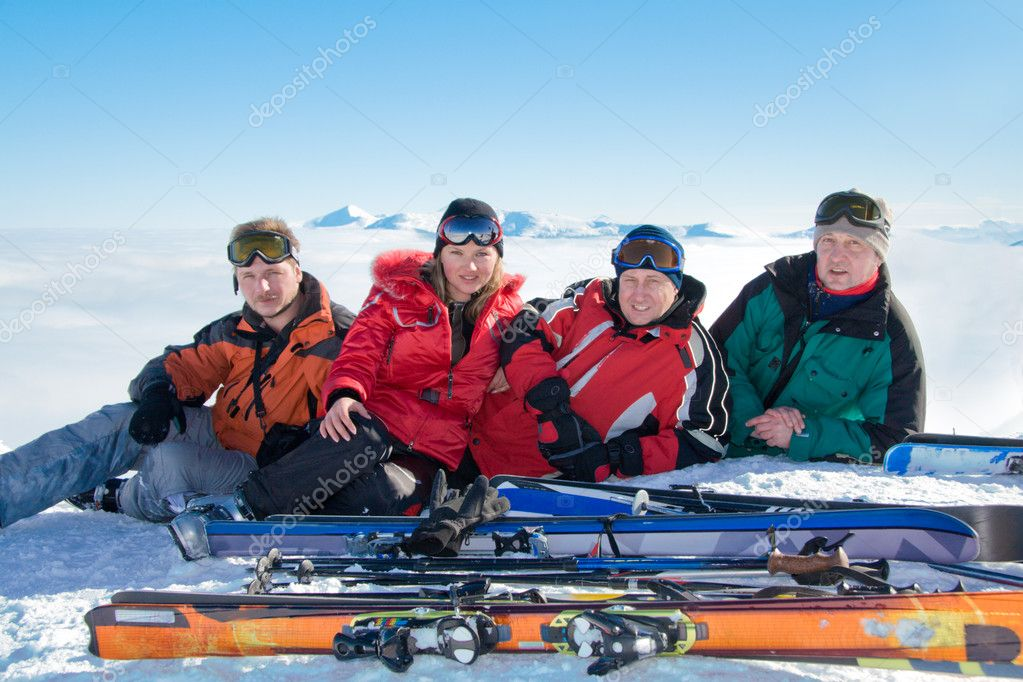 Group of skiers on the top of Stig mountain. On background Goverla is highest mountain of Ukraine. — Stock Photo #1345231