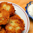 Potato pancakes with sour cream - Stock Photo