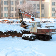 Excavator on deserted building - Stockfoto