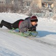 Happy asian boy on sledge — Stock Photo