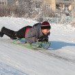 Stock Photo: Happy asian boy on sledge