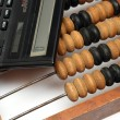 Royalty-Free Stock Photo: Old wooden abacus and electronic calcula