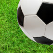 Football soccer ball over green grass — Stock Photo