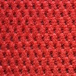 Red upholster material close-up - Stock Photo