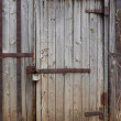 Closed wooden door of old shed — Stock Photo