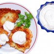 Stock Photo: Potato pancakes with sour cream isolated