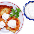 Potato pancakes with sour cream isolated - Stock Photo