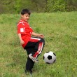 Asian boy playing football — Stock Photo #1116286