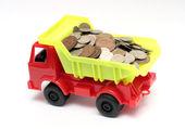Vrachtwagen met munten - bedrijfsconcept — Stockfoto