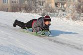 Happy asian boy on sledge — Stock Photo