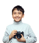 Smiling boy with camera — Stock Photo