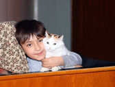 Asian boy with cat — Stock Photo