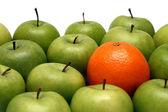 Different concepts - orange between appl — Stock Photo