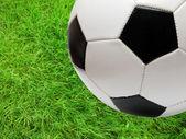 Football soccer ball over green grass — Stock Photo