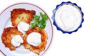 Potato pancakes with sour cream isolated — Foto Stock