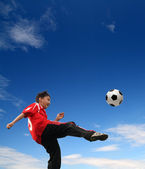 Asian boy playing football — Stock Photo