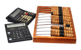 Old abacus and two calculators — Stock Photo