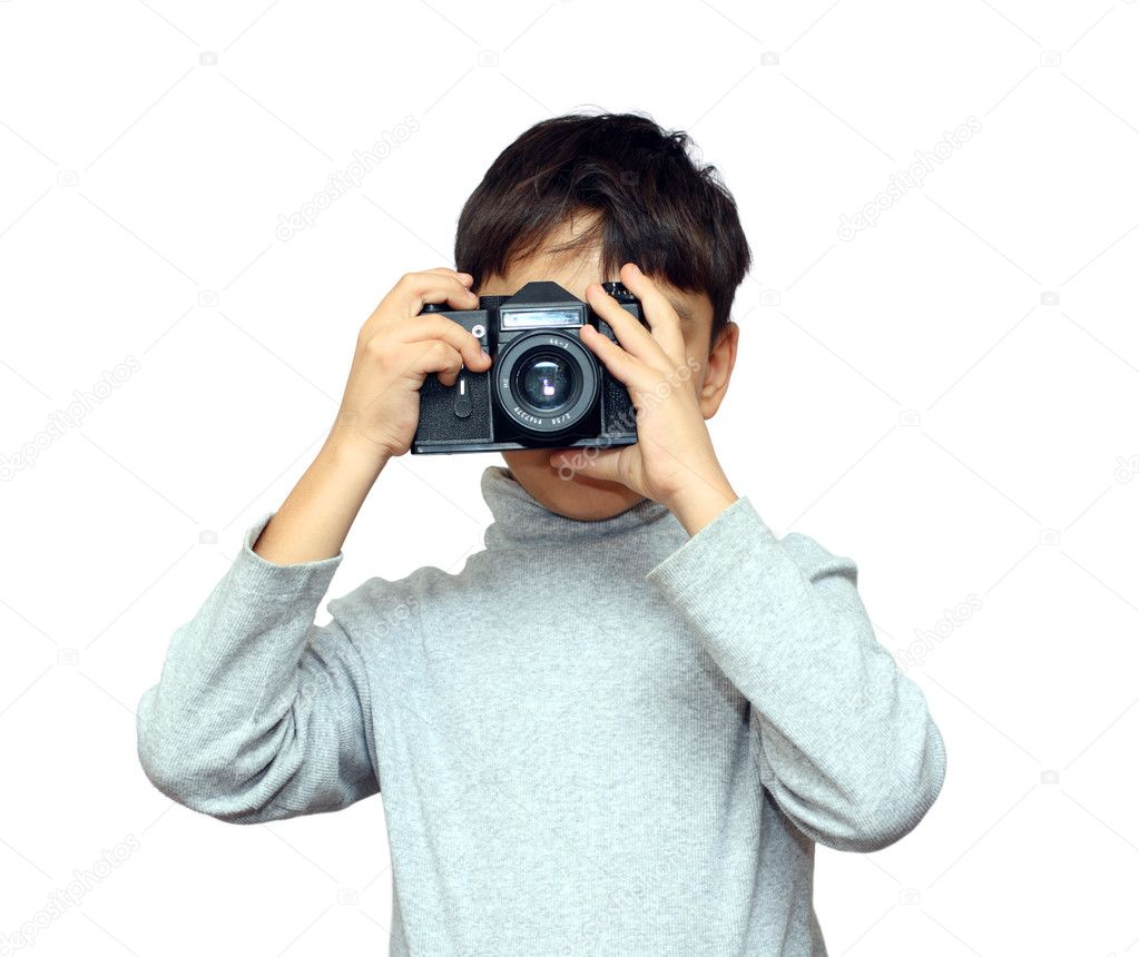 Asian boy photographing with black slr camera isolated on white — Stock Photo #1113845