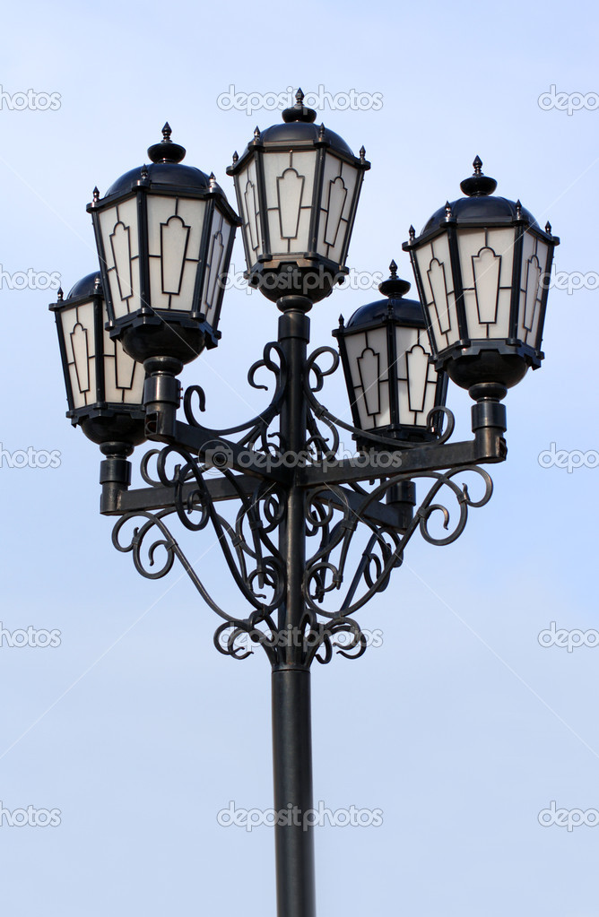 Old black street lamp under blue sky — Stock Photo #1114335