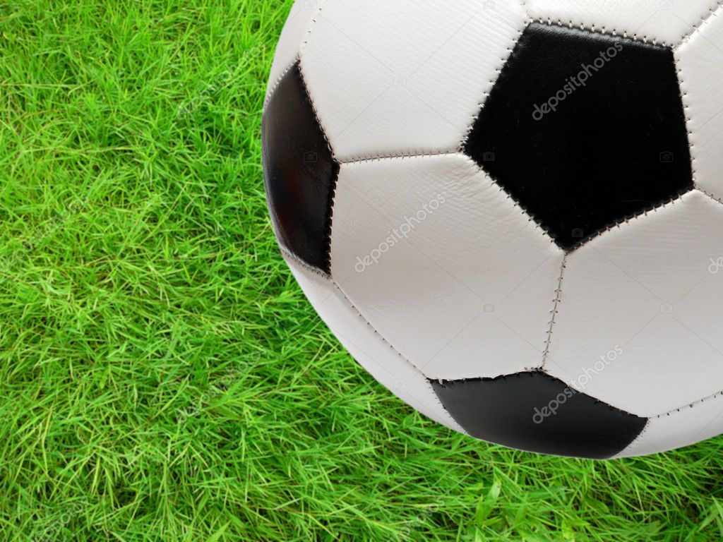 Football soccer ball close-up over green grass field — Stock Photo #1114338