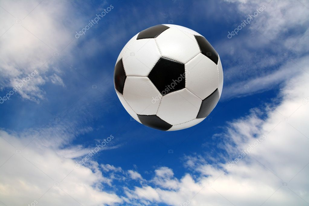 Football soccer ball under blue sky with clouds — Stock Photo #1115742