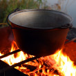Kettle over campfire — Stock Photo #1124575