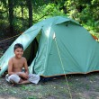 Smiling boy near tent — Stock Photo