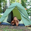 Thoughtful boy in tent — Stock Photo