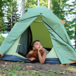 Stock Photo: Thoughtful boy in tent