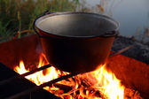 Kettle over campfire — Stock Photo
