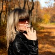 Young girl with cigarette — Stock Photo