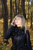 Young woman talking by phone — Stock Photo