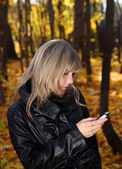 Girl messaging with phone — Stock Photo